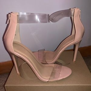 Glossy nude heels with clear straps